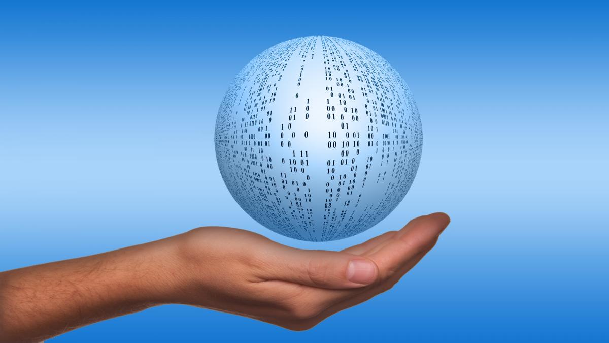 Image of Hand holding globe of data