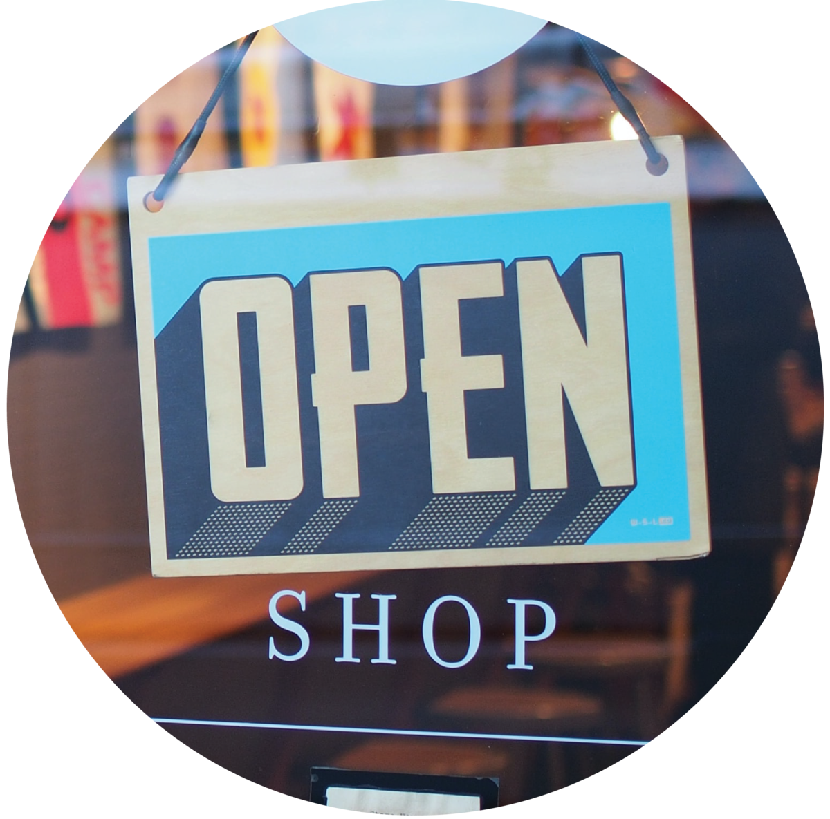 "Sign on a window that reads ""Open"" above text on the window that reads ""shop"""
