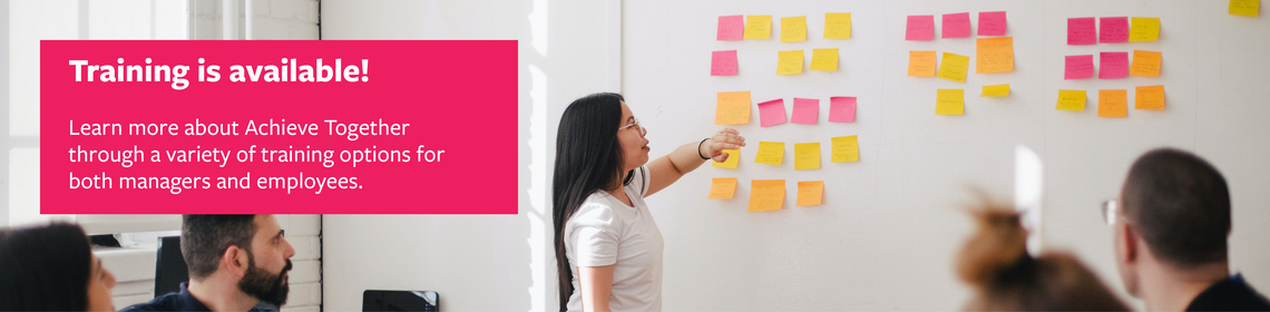 """A person points to post-its on a whiteboard. Text reads """"Training is available! Learn more about Achieve Together through a vari"""